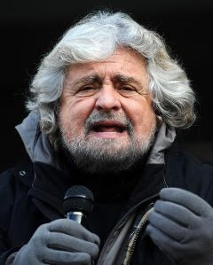 Beppe Grillo on the tribune of the Five Star Movement at Piazza Dante in Trento during the collection of signatures for the presentation of the lists for the political elections in 2013. (by Niccolò Caranti)