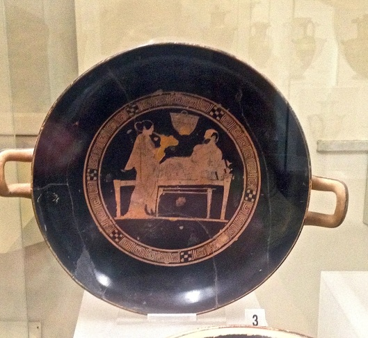 Drinking bowl showing a man reclining to drink wine.