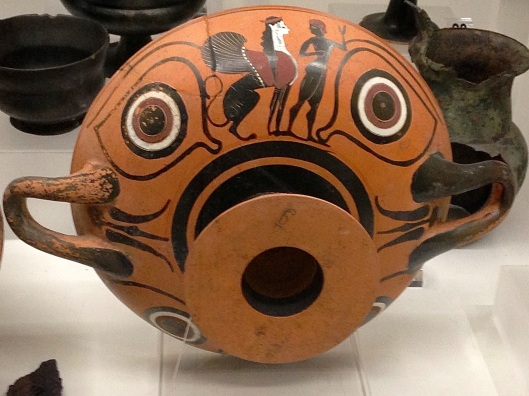 Bowl with mask-like design.