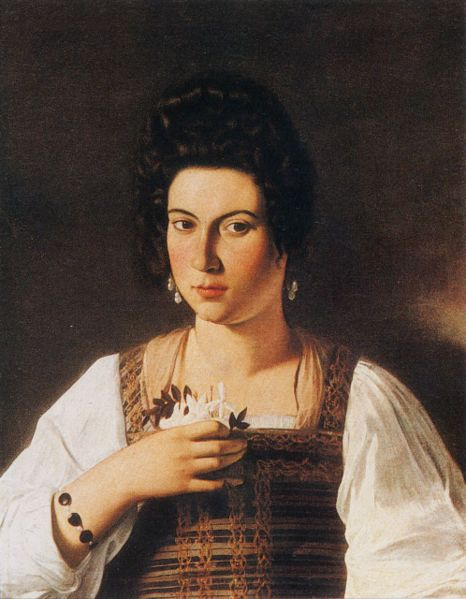 Fillide, at about 17, by Caravaggio (1597). She holds a sprig of Jasmine, a symbol of erotic love.